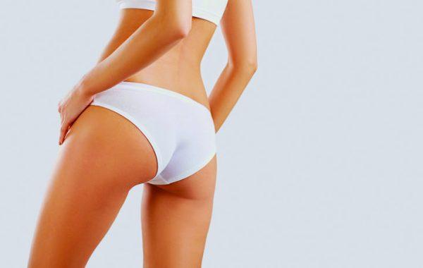 Slim woman's body in shape. Close-up of butt girl in underwear.